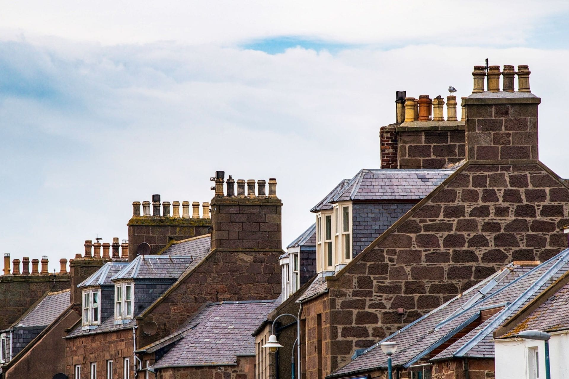 roofs-and-chimneys-of-row-of-terraced-houses