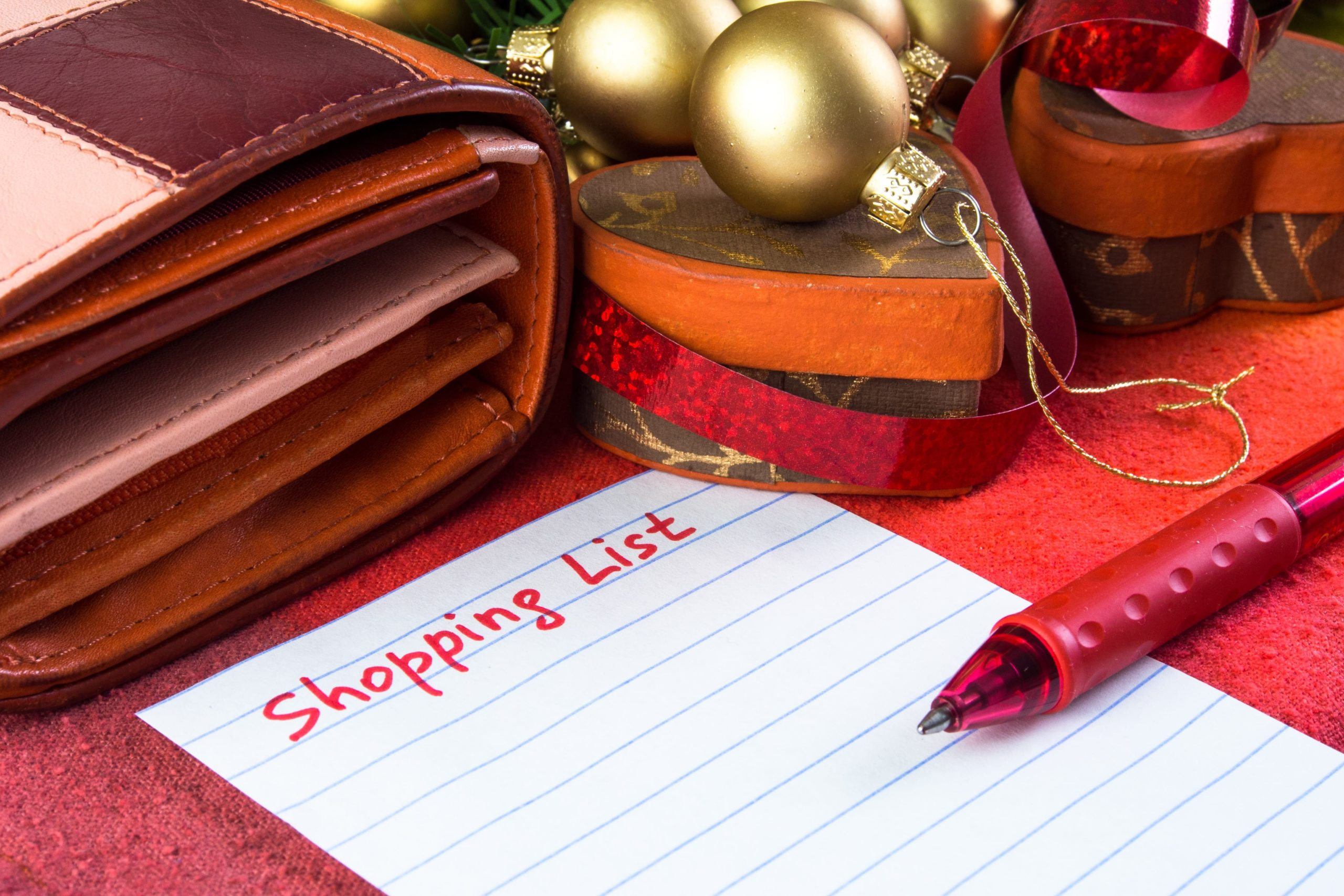 shopping-list-on-piece-of-white-paper-with-a-red-pen-at-christmas